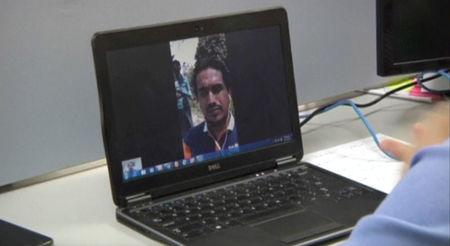 Ata Ullah, who has been identified by analysts and local people as the leader of Rohingya Muslim insurgency Arakan Rohingya Salvation, is seen on a laptop screen during a Skype interview with Reuters in Yangon Myanmar, in this still image taken from video taken March 31, 2017.  via REUTERS TV