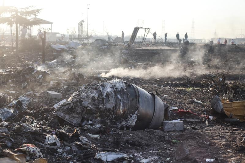 08 January 2020, Iran, Shahedshahr: Debris of an aircraft lay at the scene, where a Ukrainian airplane carrying 176 people crashed on Wednesday shortly after takeoff from Tehran airport, killing all onboard. Photo: Mahmoud Hosseini/dpa (Photo by Mahmoud Hosseini/picture alliance via Getty Images)