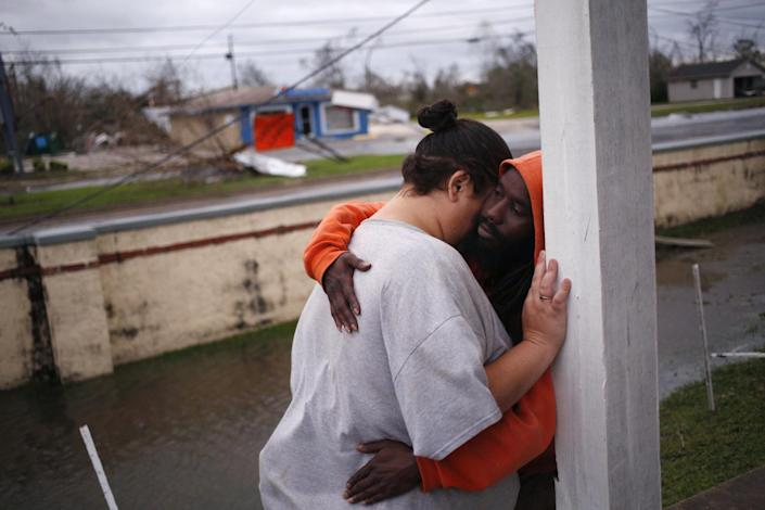 <p>Residents embrace in front of an apartment building after Hurricane Michael hit in Panama City, Florida, U.S., on Wednesday, Oct. 10, 2018. (Photo: Luke Sharrett/Bloomberg via Getty Images) </p>