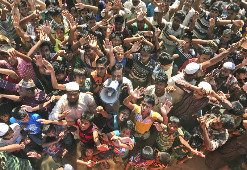 Rohingya refugees shout slogans against repatriation at Unchiprang camp near Cox's Bazar, in Bangladesh, Thursday, Nov. 15, 2018. About 1,000 Rohingya Muslim refugees demonstrated Thursday at a camp in Bangladesh against plans to repatriate them to Myanmar, from where hundreds of thousands fled army-led violence last year. (AP Photo/Dar Yasin)
