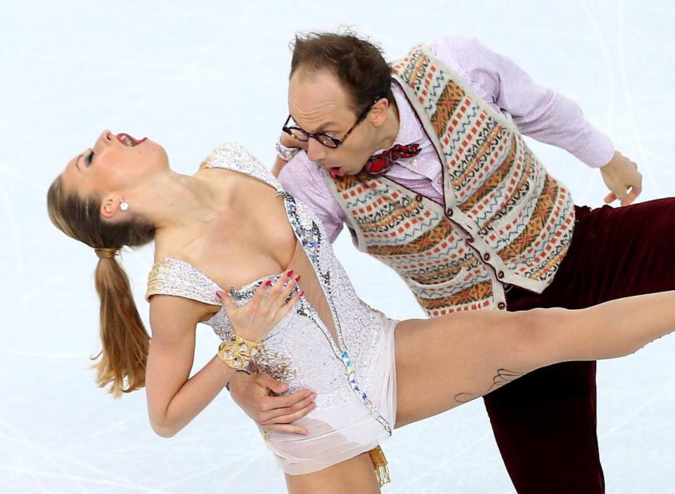<p>Who would've guessed that sweater vests and elbow patches be part of Olympic figure skating? l German Alexander Gazsi made it part of his outfit at the 2014 Sochi Games while his partner, Nelli Zhiganshina, wore a more traditional white leotard. </p>