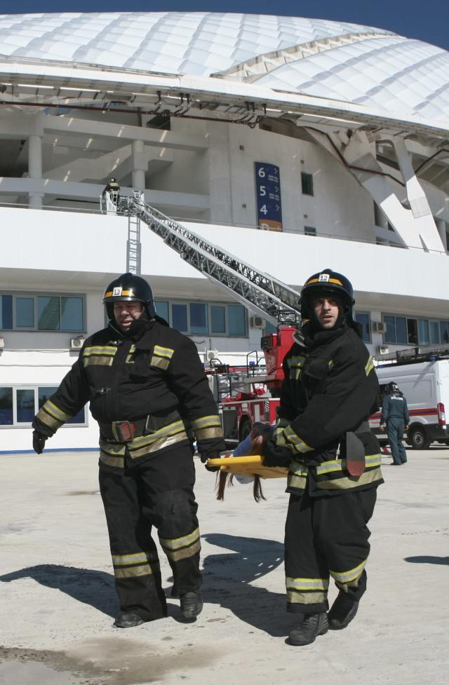 Members of the Russian Emergencies Ministry hold a drill, dedicated to fire fighting and an emergency response during international competitions, outside the Fisht Olympic Stadium, which will host matches of the 2018 FIFA World Cup, in Sochi, Russia April 5, 2018. REUTERS/Kazbek Basayev
