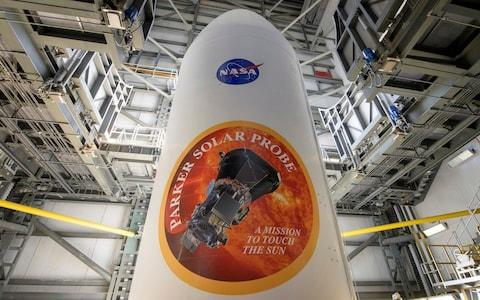 The United Launch Alliance Delta IV Heavy rocket payload fairing is seen with the NASA and Parker Solar Probe emblems - Credit:  Bill Ingalls/NASA