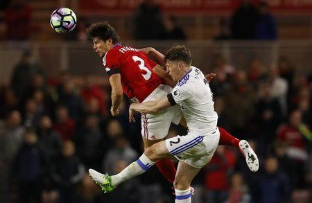 Middlesbrough's George Friend and Sunderland's Billy Jones challenge for a ball in the air