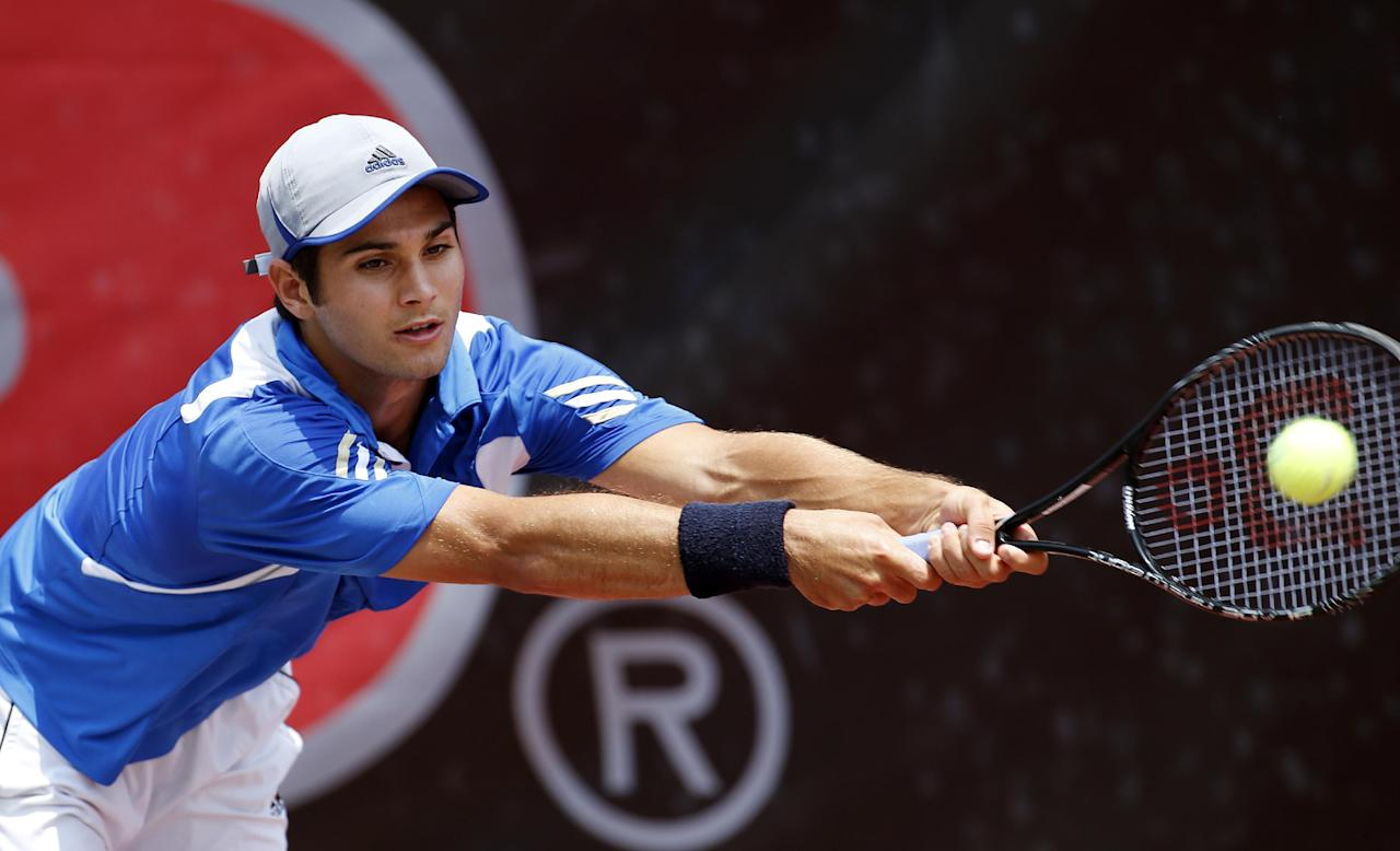 UCLA's Marcos Giron returns a shot during the final match of the NCAA men's tennis championship against Pepperdine's Alex Sarkissian Monday, May, 26, 2014 in Athens, Ga.. (AP Photo/John Bazemore)