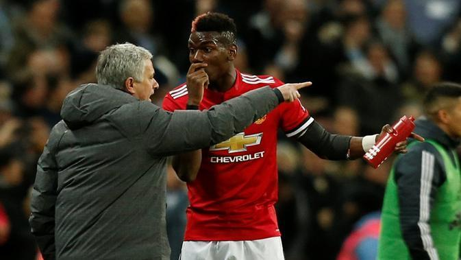 Jose Mourinho, dan Paul Pogba (AFP/Ian Kington)