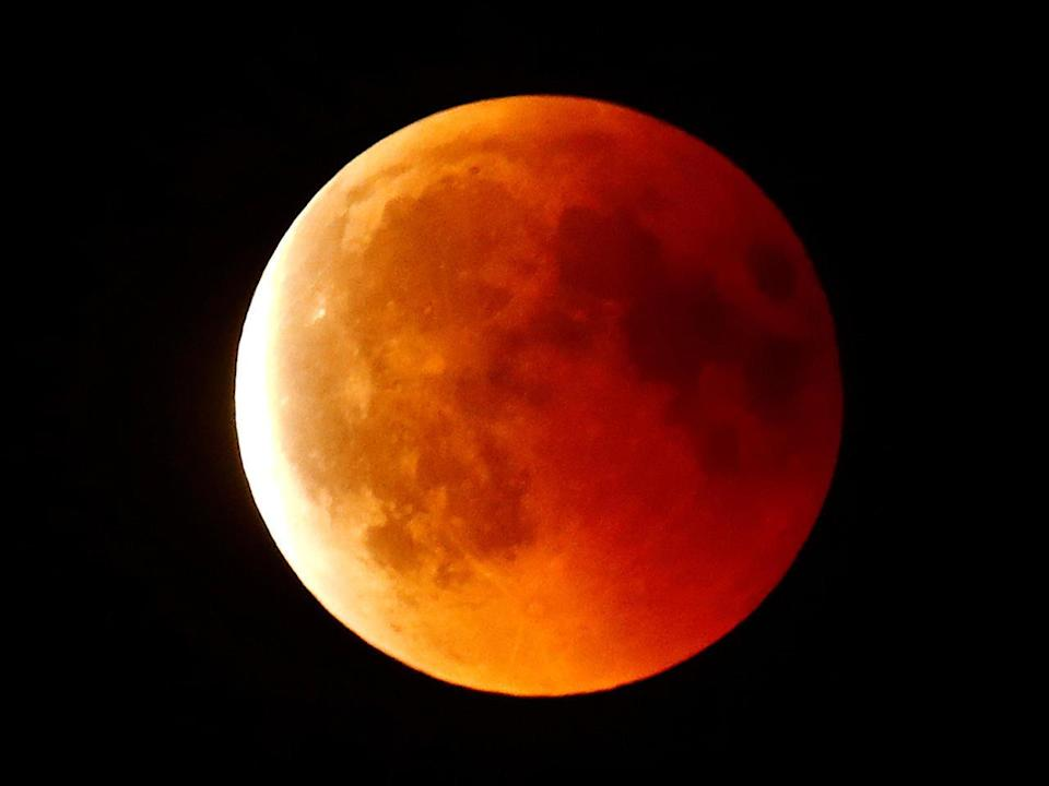 A blood moon is seen in the sky over Frankfurt, Germany, July 27, 2018. / Credit: KAI PFAFFENBACH / REUTERS