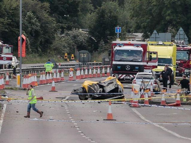 Emergency services attend the scene of the crash on the A27 in August 2015: PA