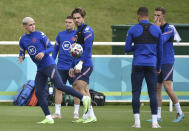England's Jack Grealish watches as Phil Foden controls the ball during a training session at St George's Park, Burton upon Trent, England, Monday July 5, 2021, ahead of their Euro 2020 soccer championship semifinal match against Denmark in London on Wednesday. (AP Photo/Rui Vieira)