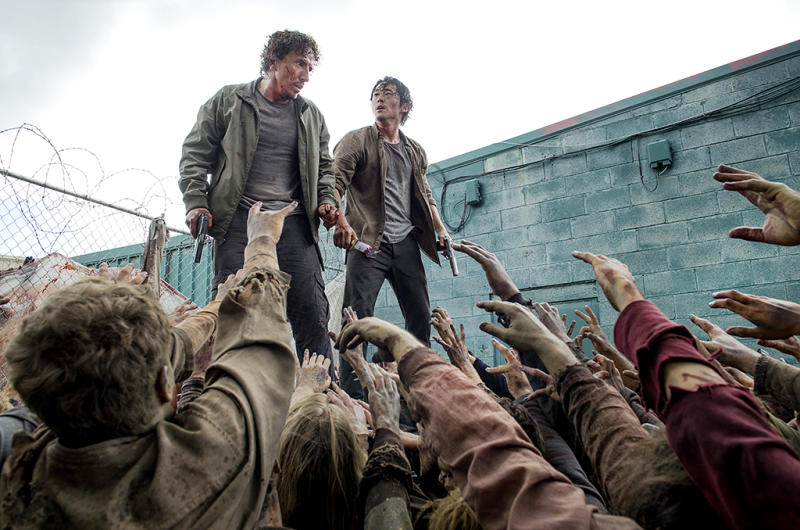 Michael Traynor as Nicholas and Steven Yeun as Glenn Rhee in AMC's The Walking Dead.
