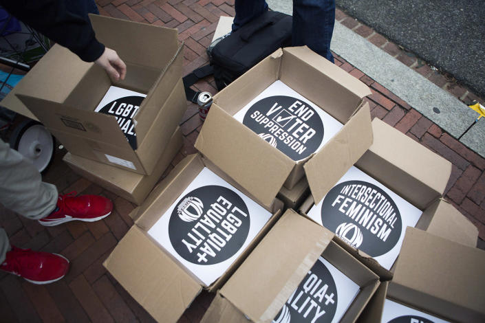 <p>Free signs are handed out to demonstrators as they arrive at Union Station for the Women's March on Washington on January 21, 2017, in Washington, D.C. (Jessica Kourkounis/Getty Images) </p>