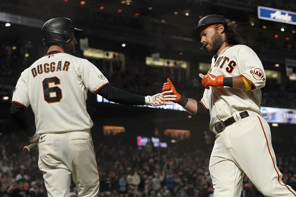 San Francisco Giants' Brandon Crawford, right, is congratulated by Steven Duggar after scoring a run against the San Diego Padres during the second inning of a baseball game in San Francisco, Wednesday, Sept. 15, 2021. (AP Photo/Jeff Chiu)