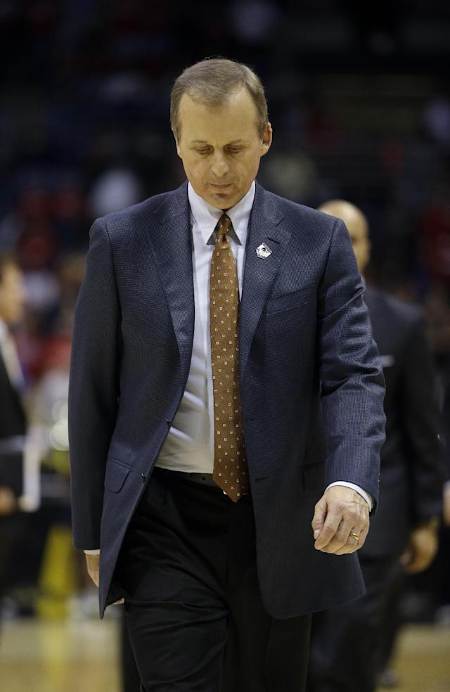 Texas head coach Rich Barnes walks off the court after a third-round game of the NCAA college basketball tournament Saturday, March 22, 2014, in Milwaukee. Michigan won 79-65. (AP Photo/Morry Gash)