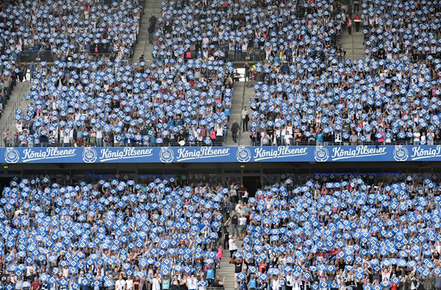Soccer Football - Bundesliga - Hamburger SV v Borussia Moenchengladbach - Volksparkstadion, Hamburg, Germany - May 12, 2018 General view of Hamburger SV fans holding up banners before the match REUTERS/Fabian Bimmer DFL RULES TO LIMIT THE ONLINE USAGE DURING MATCH TIME TO 15 PICTURES PER GAME. IMAGE SEQUENCES TO SIMULATE VIDEO IS NOT ALLOWED AT ANY TIME. FOR FURTHER QUERIES PLEASE CONTACT DFL DIRECTLY AT + 49 69 650050