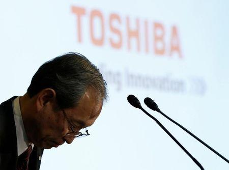 Toshiba Corp CEO Tsunakawa bows at the start of a news conference at the company's headquarters in Tokyo