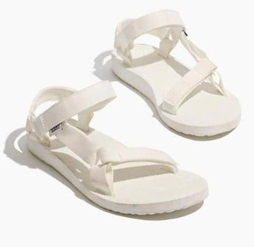"<p>The nostalgic Teva gets a refresh in all white. </p> <p><a href=""https://www.popsugar.com/buy/Teva-Original-Universal-Sandal-White-573106?p_name=Teva%20Original%20Universal%20Sandal%20in%20White&retailer=madewell.com&pid=573106&price=50&evar1=fab%3Aus&evar9=47446893&evar98=https%3A%2F%2Fwww.popsugar.com%2Fphoto-gallery%2F47446893%2Fimage%2F47463181%2FTeva-Original-Universal-Sandal&list1=sandals%2Cshoes%2Ctrends%2Csummer%2Cteva%2Cfashion%20shopping&prop13=api&pdata=1"" class=""link rapid-noclick-resp"" rel=""nofollow noopener"" target=""_blank"" data-ylk=""slk:Teva Original Universal Sandal in White"">Teva Original Universal Sandal in White</a> ($50) </p>"