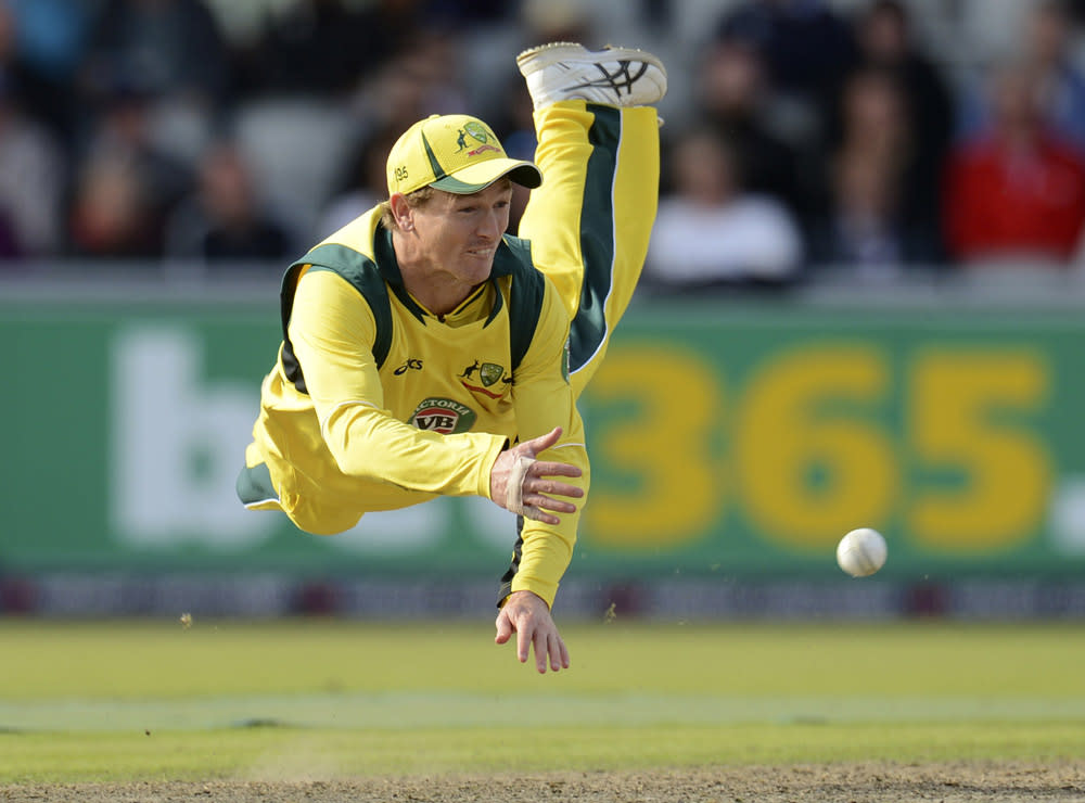 Australia's George Bailey is airborne as he throws the ball attempting a run out during the second one-day international against England at Old Trafford cricket ground in Manchester September 8, 2013. REUTERS/Philip Brown (BRITAIN - Tags: SPORT CRICKET TPX IMAGES OF THE DAY)
