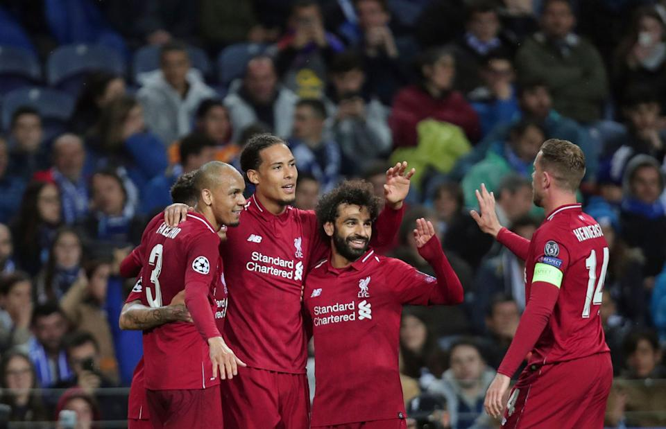 Liverpool's Virgil van Dijk celebrates with teammates after scoring his side's fourth goal during the Champions League quarterfinals, 2nd leg, soccer match between FC Porto and Liverpool at the Dragao stadium in Porto, Portugal, Wednesday, April 17, 2019. (AP Photo/Luis Vieira)