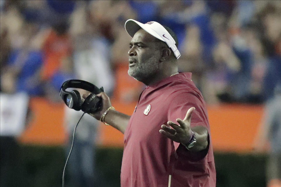 Florida State interim head coach Odell Haggins questions a ruling by officials during the first half of an NCAA college football game against Florida, Saturday, Nov. 30, 2019, in Gainesville, Fla. (AP Photo/John Raoux)