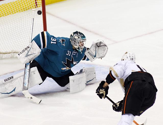 Anaheim Ducks' Corey Perry, front, scores over San Jose Sharks goalie Antti Niemi during the first period of an NHL hockey game Saturday, Nov. 30, 2013, in San Jose, Calif. (AP Photo/George Nikitin)