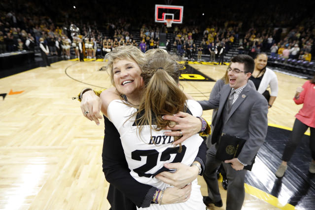FILE - In this March 24, 2019, file photo, Iowa coach Lisa Bluder gets a hug from guard Kathleen Doyle (22) after the team's second-round game against Missouri in the NCAA women's college basketball tournament in Iowa City, Iowa. Iowa has won six straight games and is on a 30-game home win streak, second-longest in the nation behind Baylor's 49-game streak. (AP Photo/Charlie Neibergall, File)