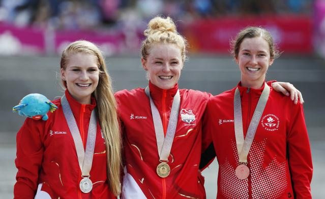 Cycling Cross-Country - Gold Coast 2018 Commonwealth Games - Mountain Bike - Women's Cross-Country - Nerang Mountain Bike Trails - Gold Coast, Australia - April 12, 2018. Gold medallist Annie Last of England, silver medallist Evie Richards of England and bronze medallist Haley Smith of Canada pose with their medals. REUTERS/Paul Childs