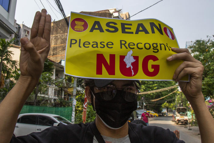 An anti-coup protester flashes the three-finger salute during the demonstration against the military coup in Yangon, Myanmar, on Friday, April 23, 2021. Leaders of the 10-member Association of Southeast Asian Nations meet Saturday, April 24, in Jakarta to consider plans to promote a peaceful resolution of the conflict that has wracked Myanmar since its military launched a deadly crackdown on opponents to its seizure of power in February. (AP Photo)
