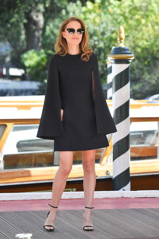 <p>Natalie Portman was the definition of chic as she arrived at Venice Film Festival on 4 September. The actress wore an A-line cape dress accessorised with nineties-inspired heels. <em>[Photo: Getty]</em> </p>