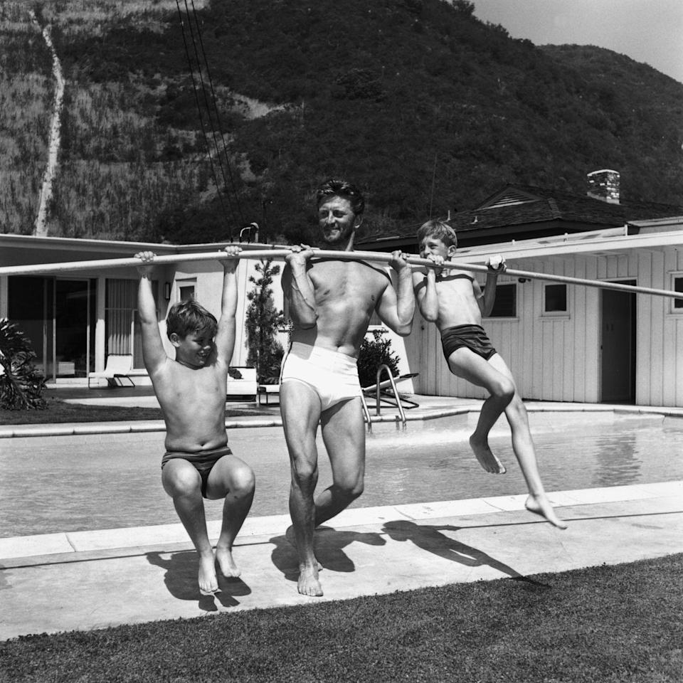 <p>Kirk goofs around with sons Michael and Joel, who both followed their father into the film industry.<br></p>