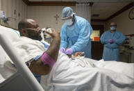 COVID-19 patient Cedric Daniels, 37, of Gonzales, La., recuperates at Our Lady of the Lake Regional Medical Center in Baton Rouge, Monday, Aug. 2, 2021. Louisiana is leading the nation in the number of new COVID cases per capita and remains one of the bottom five states in administering vaccinations. (AP Photo/Ted Jackson)