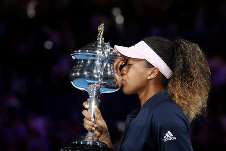 Tennis - Australian Open - Women's Singles Final - Melbourne Park, Melbourne, Australia, January 26, 2019. Japan's Naomi Osaka kisses her trophy after winning her match against Czech Republic's Petra Kvitova. REUTERS/Kim Kyung-Hoon