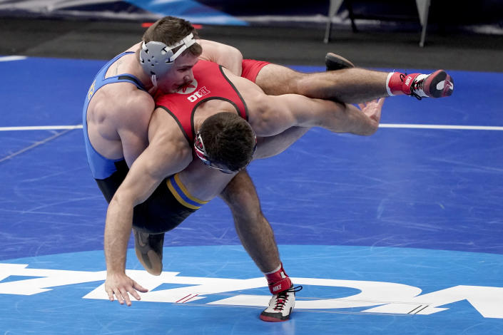 Pittsburgh's Jake Wentzel, left, takes on Ohio State's Ethan Smith during their 165-pound match in the semifinal round of the NCAA wrestling championships Friday, March 19, 2021, in St. Louis. (AP Photo/Jeff Roberson)