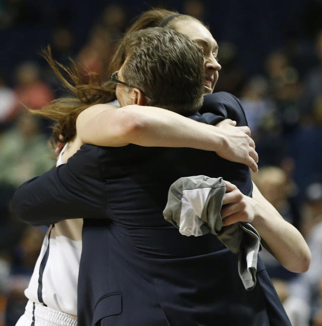 Connecticut forward Breanna Stewart embraces Connecticut head coach Geno Auriemma after the second half of the semifinal game against Stanford in the Final Four of the NCAA women's college basketball tournament, Sunday, April 6, 2014, in Nashville, Tenn. Connecticut won 75.56. (AP Photo/John Bazemore)