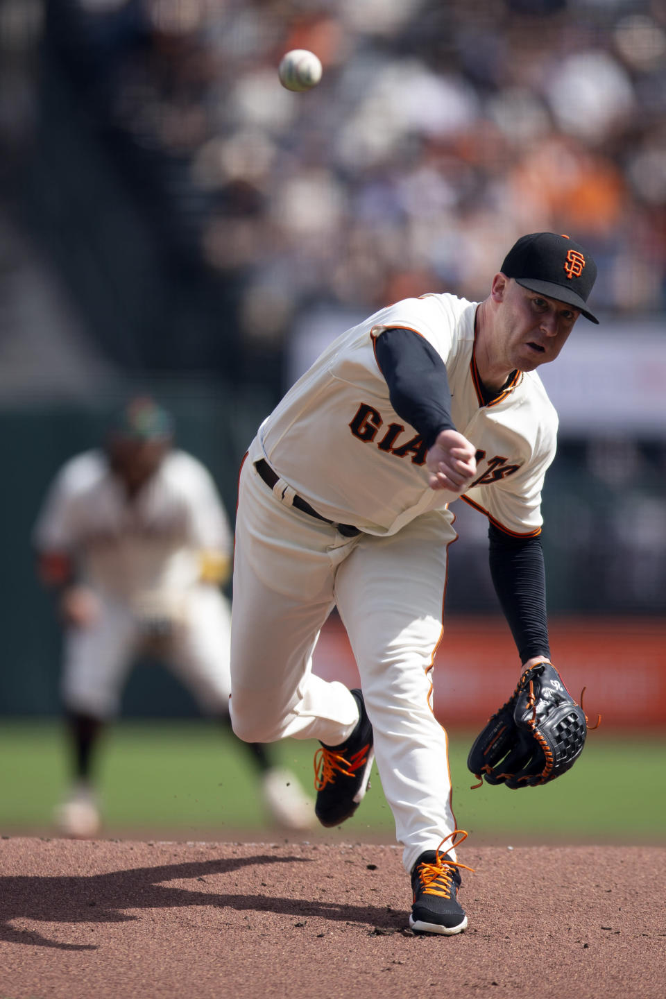 San Francisco Giants starting pitcher Anthony DeSclafani delivers against the Atlanta Braves during the first inning of a baseball game, Sunday, Sept. 19, 2021, in San Francisco. (AP Photo/D. Ross Cameron)