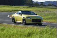 "<p>Shown today for the first time in a bright yellow paint, the front end of the Z Proto is unmistakably inspired by the original <a href=""https://www.roadandtrack.com/car-culture/a10273163/first-drive-datsun-240z/"" rel=""nofollow noopener"" target=""_blank"" data-ylk=""slk:240Z"" class=""link rapid-noclick-resp"">240Z</a> of the Seventies. </p>"