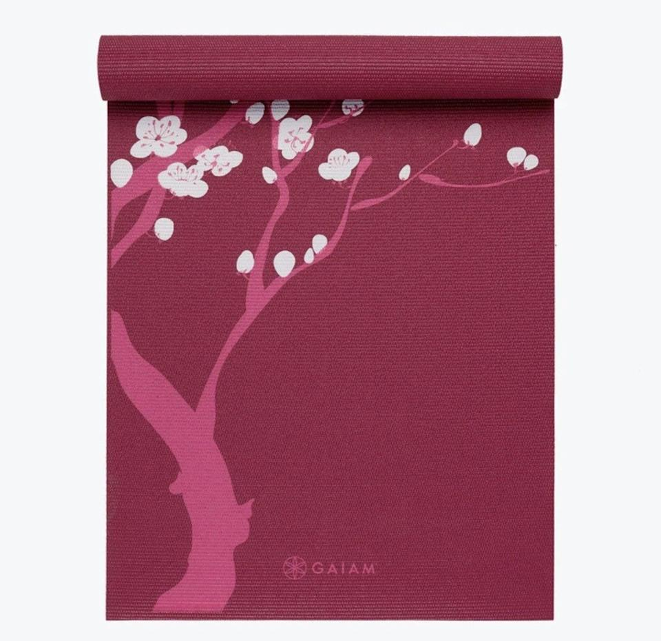 <p>Gaiam has so many different printed yoga mats that it is hard to choose just one, but the <span>Premium Pink Cherry Blossom Mat</span> ($30) is totally on theme for practicing your tree pose.</p>