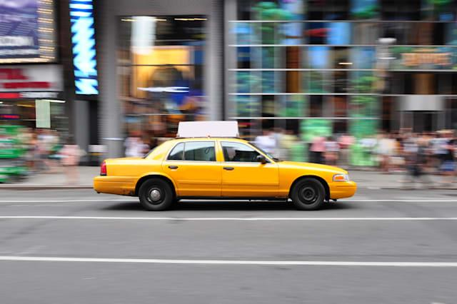 panning shot of a nyc taxi cab...