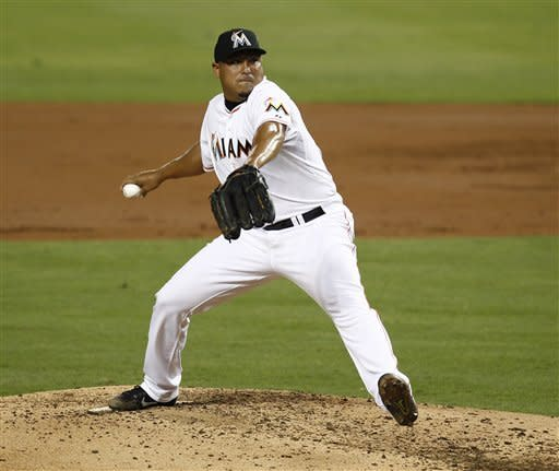 Miami Marlins starter Carlos Zambrano pitches to the Washington Nationals during the second inning of a baseball game in Miami, Monday, July 16, 2012. (AP Photo/J Pat Carter)