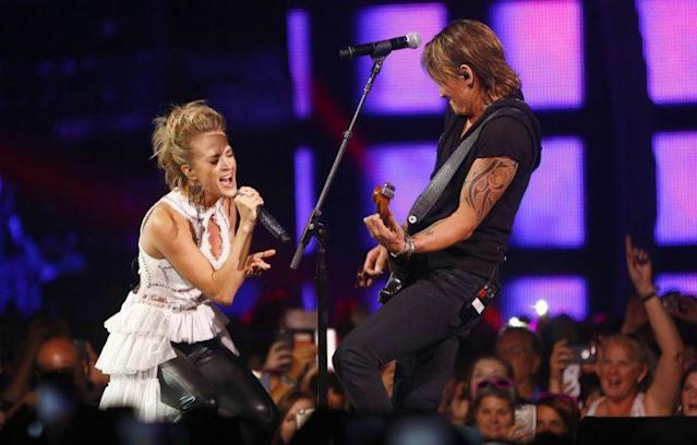 "Carrie Underwood, left, and Keith Urban perform ""The Fighter"" at the CMT Music Awards. (Photo by Wade Payne/Invision/AP)"