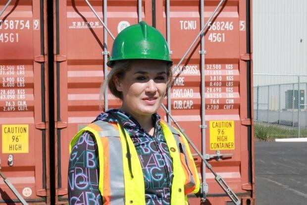 Hanna Graham, 20, comes from a family of longshoremen. She recently became one of the first women to pass the container lashing test at Port Saint John. It's the second job she's ever had. (Julia Wright/CBC - image credit)