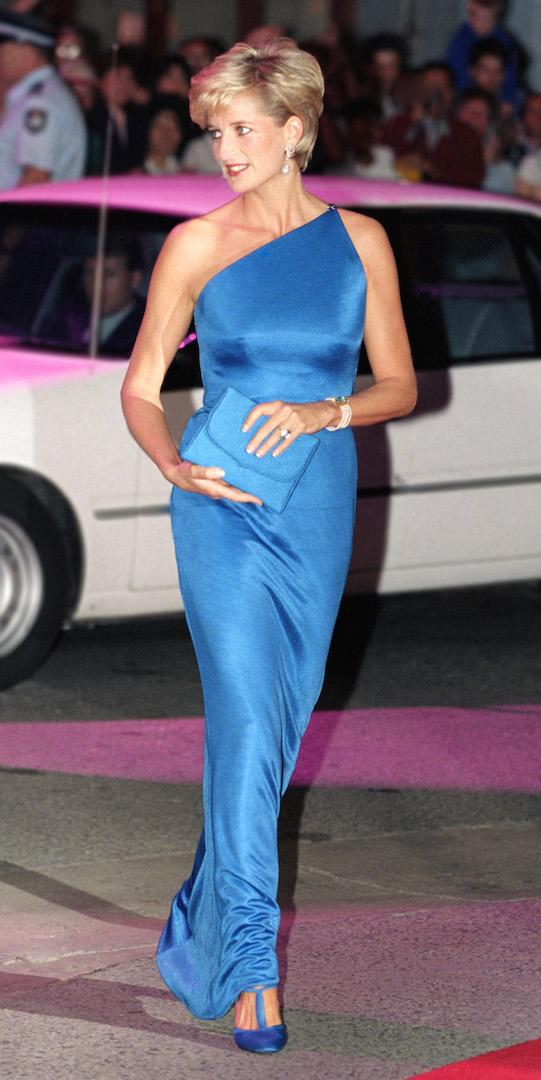 The royal attended the Victor Chang Research Institute Dinner Dance during her stay in Sydney. For the occasion, she chose a one-shoulder Versace gown in sky blue complete with matching accessories. <em>[Photo: Getty]</em>