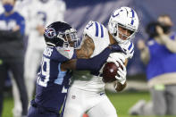 Indianapolis Colts wide receiver Michael Pittman (11) hangs onto a pass as he is defended by Tennessee Titans cornerback Breon Borders (39) in the first half of an NFL football game Thursday, Nov. 12, 2020, in Nashville, Tenn. (AP Photo/Wade Payne)