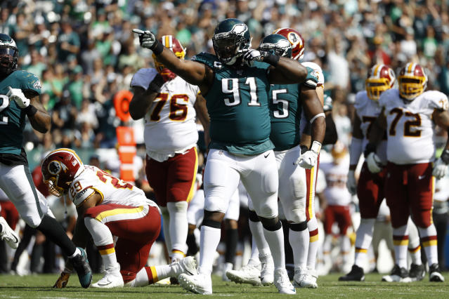 Philadelphia Eagles' Fletcher Cox (91) celebrates after tackling Washington Redskins' Derrius Guice during the second half of an NFL football game Sunday, Sept. 8, 2019, in Philadelphia. (AP Photo/Michael Perez)