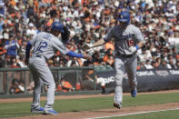 Los Angeles Dodgers' Will Smith, right, is congratulated by third base coach Dino Ebel (12) after hitting a two-run home run against the San Francisco Giants during the first inning of a baseball game in San Francisco, Sunday, Sept. 29, 2019. (AP Photo/Jeff Chiu)