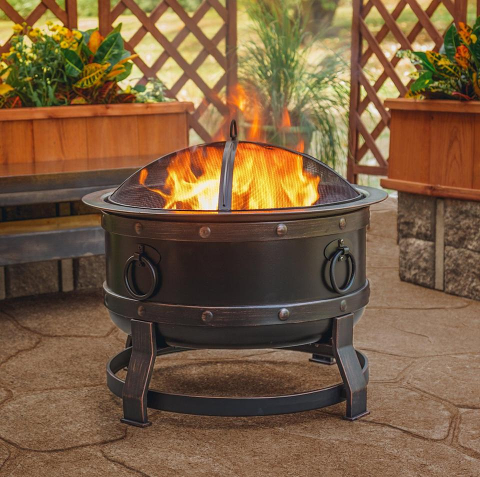 <p>Heat up the whole backyard with this large <span>Trollinger Steel Wood-Burning Fire Pit</span> ($123, originally $150).</p>