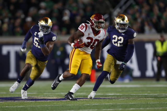 Southern California running back Markese Stepp (30) runs the ball against Notre Dame in the first half of an NCAA college football game in South Bend, Ind., Saturday, Oct. 12, 2019. (AP Photo/Paul Sancya)