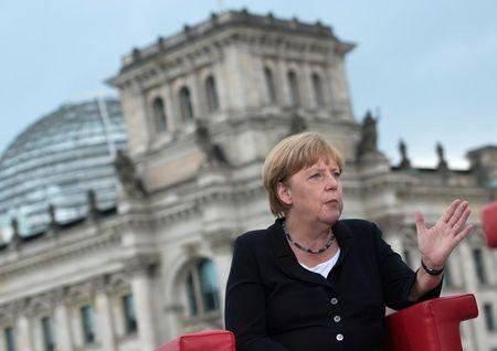 German Chancellor Angela Merkel talks during ARD summer-interview infront of the Reichstag in Berlin, Germany August 28, 2016. REUTERS/Stefanie Loos