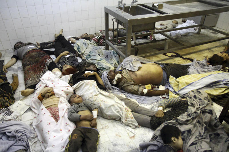 CORRECTS LOCATION - Bodies of victims of an earthquake lie in the city of Ahar in northwestern Iran, on Saturday, Aug. 11, 2012. A 6.2-magnitude earthquake hit the towns of Ahar, Haris and Varzaqan in East Azerbaijan province in northwestern Iran on Saturday, state TV said. Iran is located on seismic fault lines and is prone to earthquakes. It experiences at least one earthquake every day on average, although the vast majority are so small they go unnoticed. (AP Photo/IRNA, Kazem Yousefi)