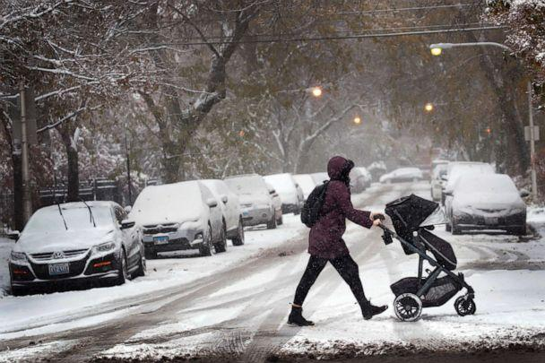 PHOTO: A resident walks through snow with her child in the Wicker Park neighborhood, Nov. 11, 2019, in Chicago, Illinois. (Scott Olson/Getty Images)