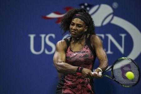 Serena Williams of the U.S. hits a return to Vitalia Diatchenko of Russia during their match at the U.S. Open Championships tennis tournament in New York, August 31, 2015. REUTERS/Lucas Jackson